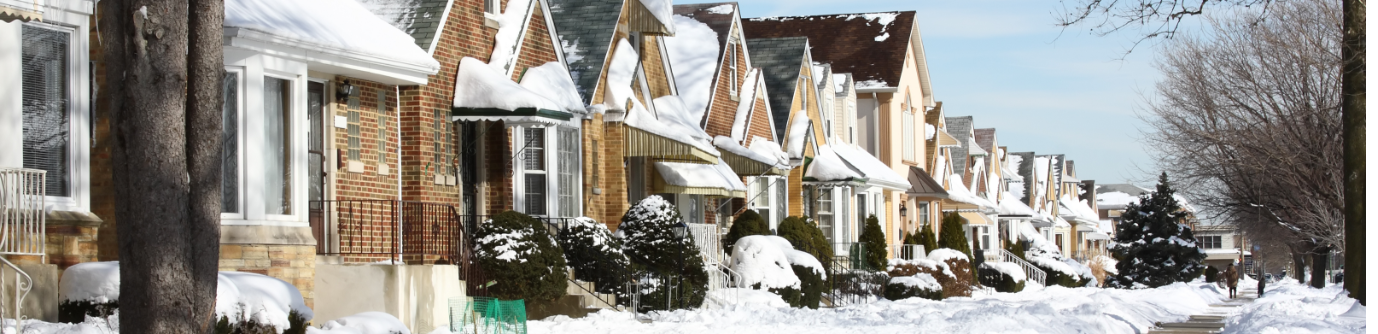 Row of Snowy homes during the winter